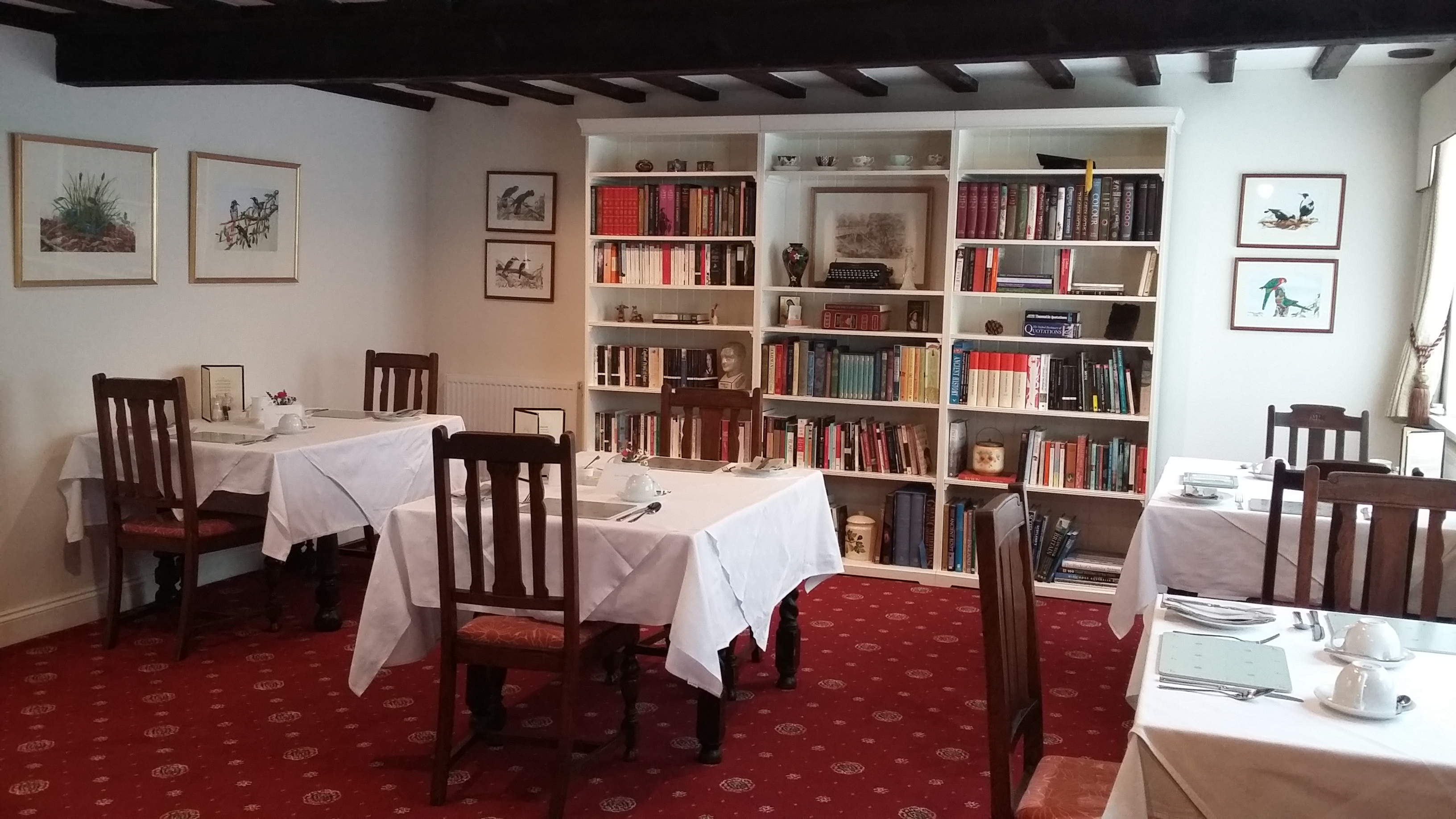 Our breakfast room and library, feel free to browse over a leisurely breakfast