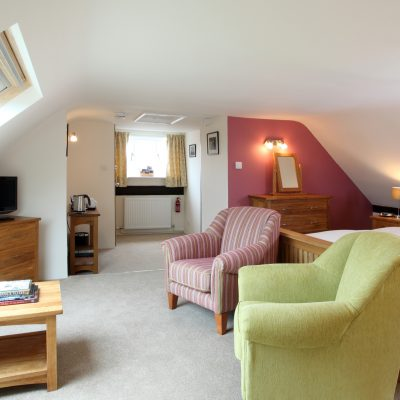 The Mill Room, situated in the attic with amazing views of the village and the surrounding countryside